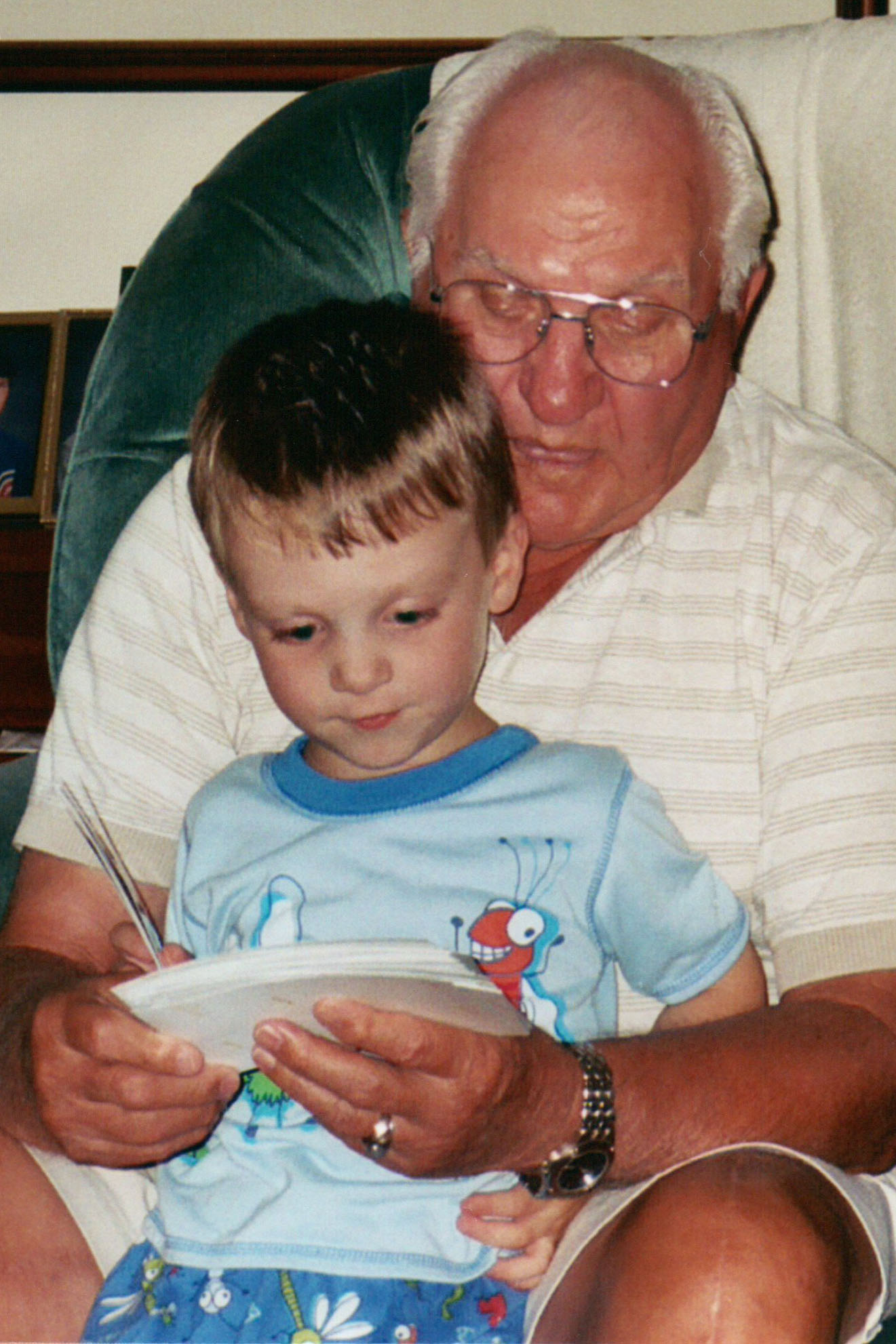 A photo of Pop-Pop-Pop looking at photos with his grandchild