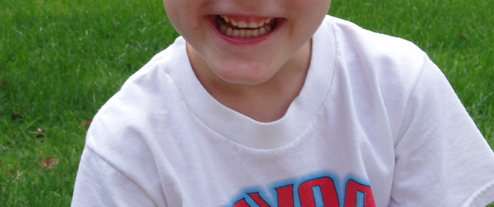 Photo of a young boy's smile.